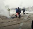 В Балаково улицу Транспортную ремонтируют во время снегопада. (Видео 18+)
